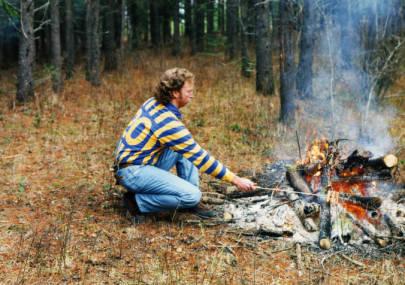 Kelvin Daniels in front of fire