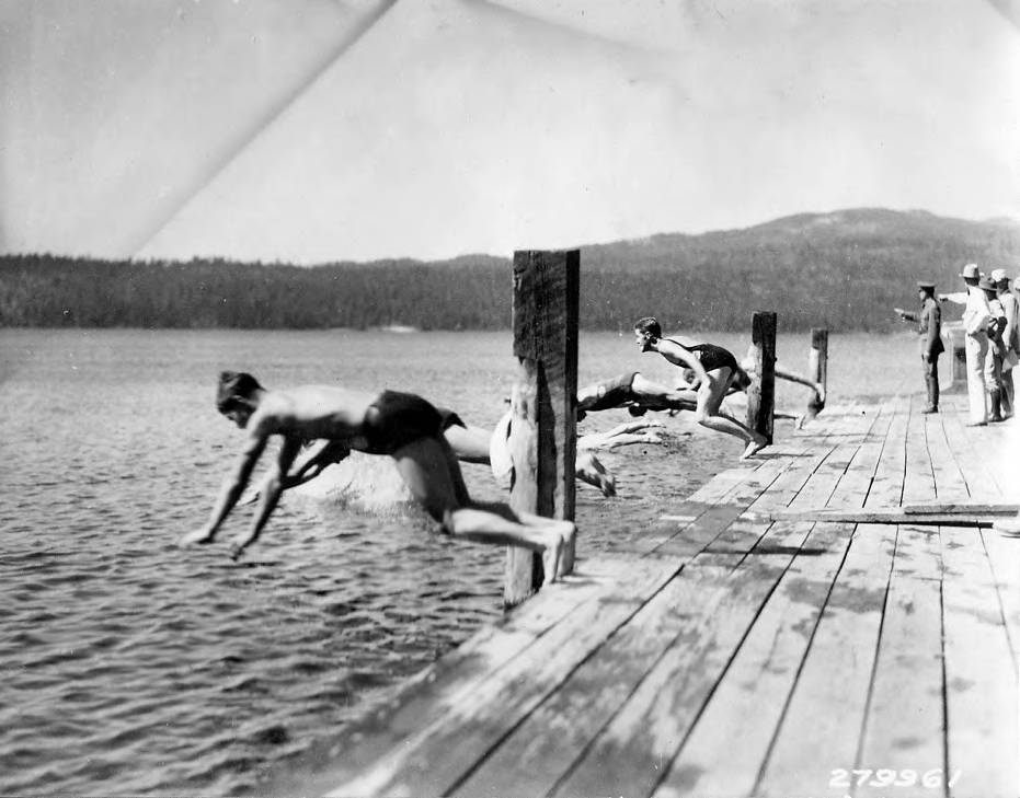 Young Men Diving into Lake during CCC Carnival