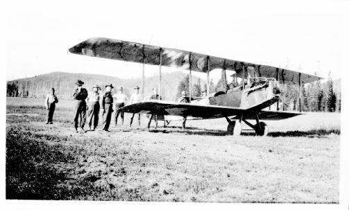 Image: Clyde Pangborn and Nick Mamer, pilots, in Hispano Standard airplane at Hog Meadows near Bovill preparing for fire spotting on CTPA lands. 1923. A.B. Curtis Collection. 13-01989